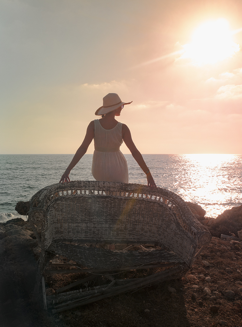 Watching the Sun Goes Down on Wicker Chair at Sea Caves Shipwreck, Paphos, Cyprus